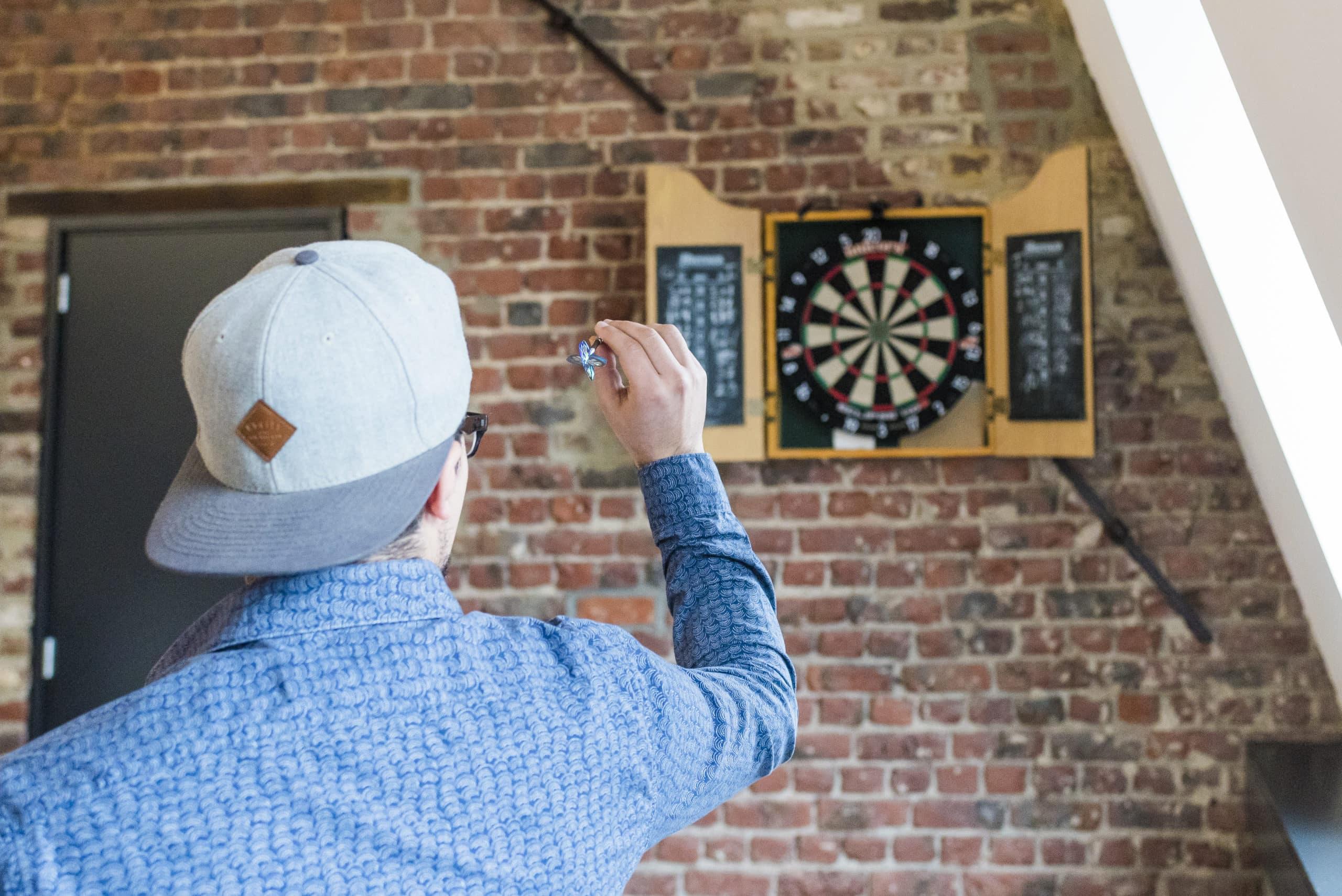 man throwing a dart